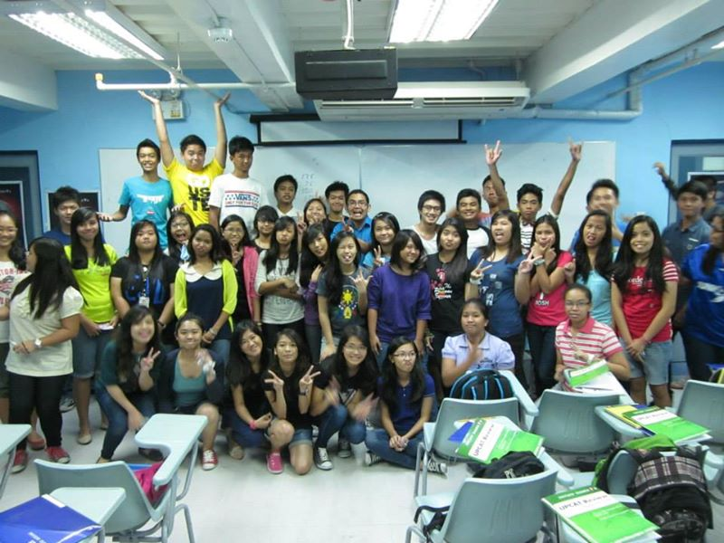 upcat review students wacky pose